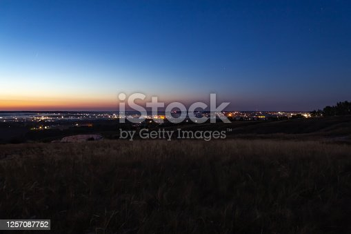sunset over the small town, view from the mountain