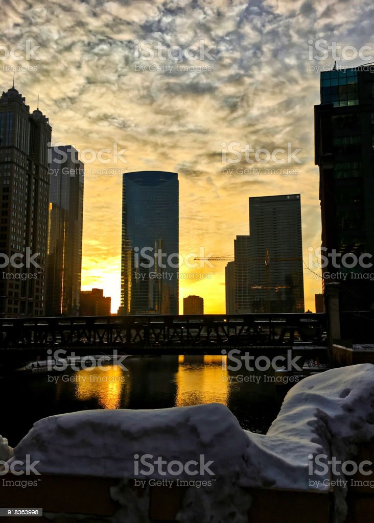 Sunset over a snowy Chicagoland and Chicago River in winter. stock photo