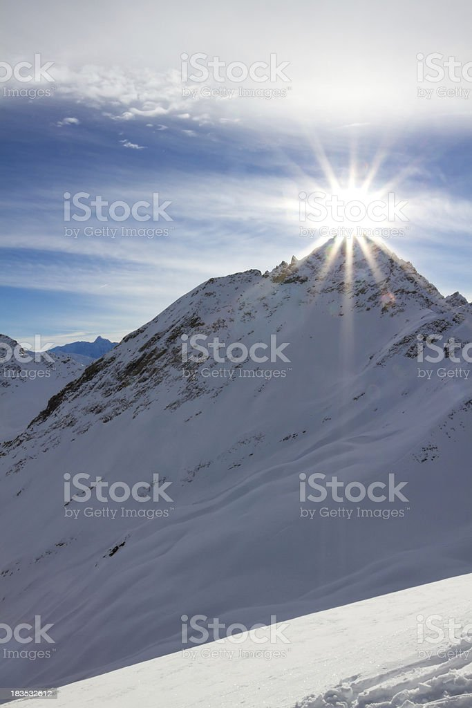 Sunset over a snowy mountain. royalty-free stock photo