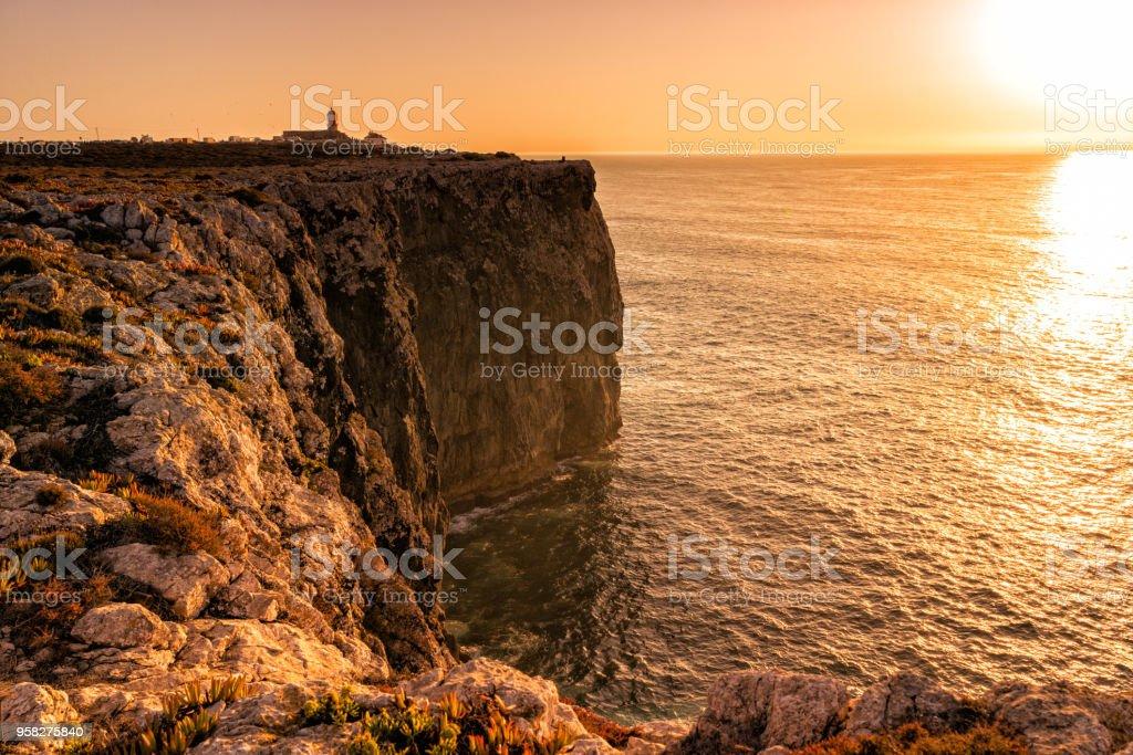 Sunset over Algarve coast.  Cape St. Vincent coast, Lagos, Portugal. stock photo