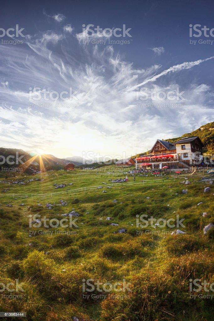 Sunset Over Alpine Lodge in Austria stock photo