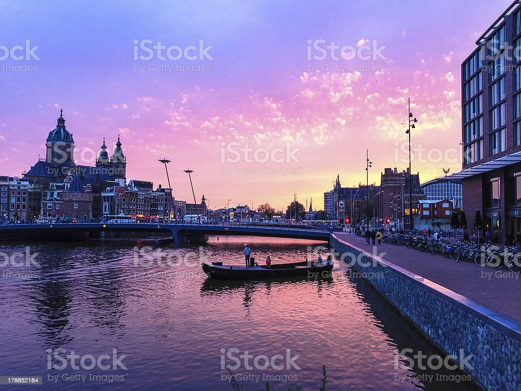 Sunset over Amsterdam St. Nicholas and Central Station royalty-free stock photo