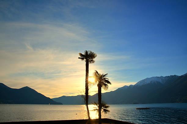 Sunset over an alpine lake stock photo