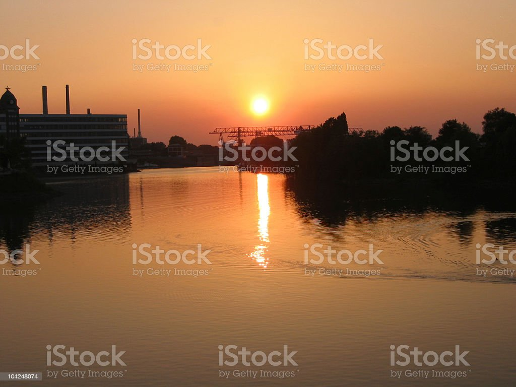 Sunset over an industrial area royalty-free stock photo