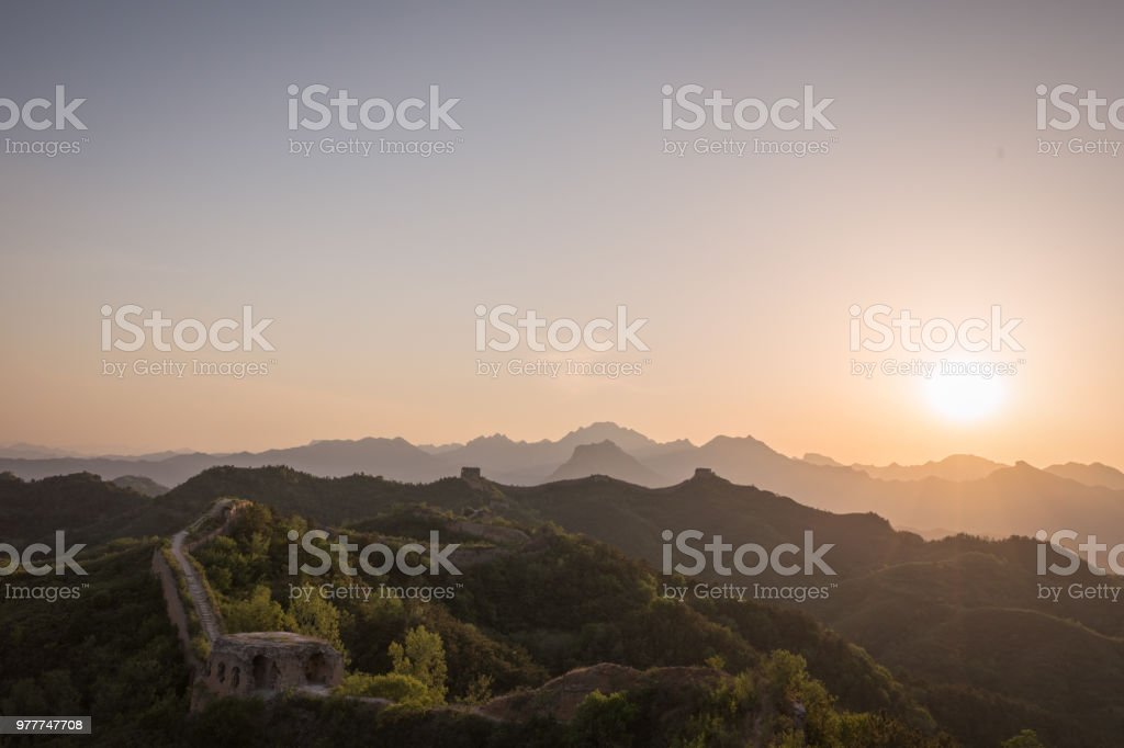 Sunset over ancient wall stock photo