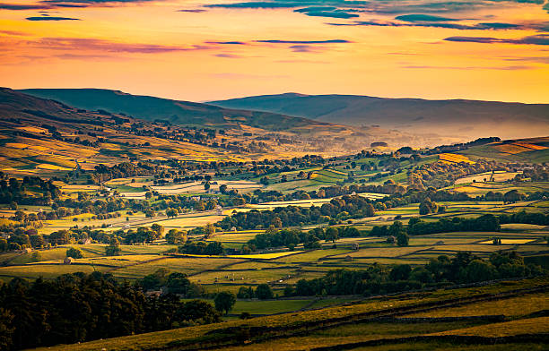 Sunset over Askrigg in Wensleydale North Yorkshire stock photo