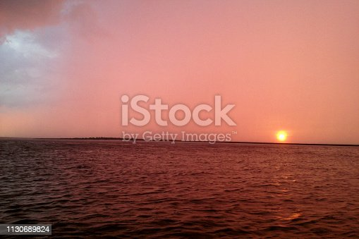 1130689824 istock photo Sunset over Atlantic Ocean 1130689824
