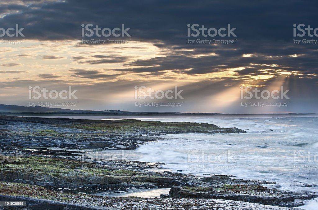 Sunset over Bamburgh Beach, Northumberland royalty-free stock photo