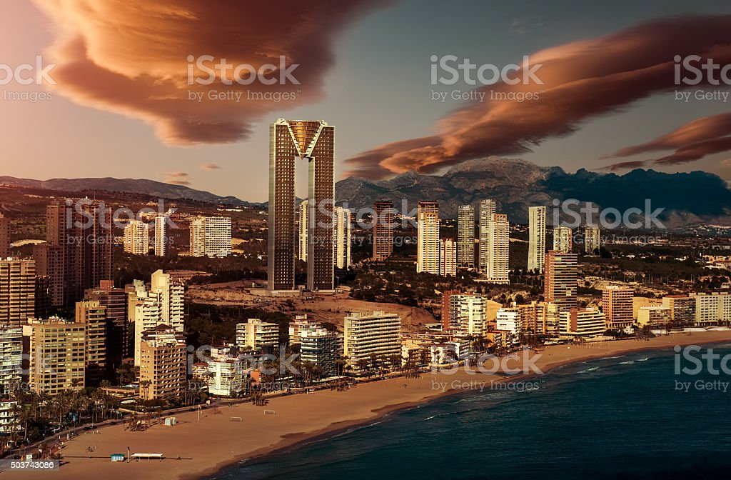 Sunset over Benidorm city stock photo