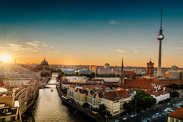 sunset over berlin with television tower and berlin cathedral panorama view on sunset over berlin with television tower and  cathedral berlin stock pictures, royalty-free photos & images