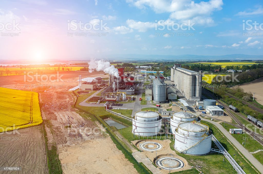 Sunset over biofuel factory stock photo