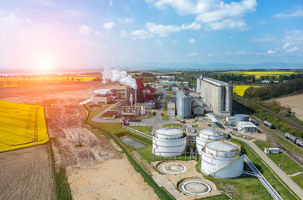 Sunset over biofuel factory Beautiful sunset over the modern biofuel factory biofuel stock pictures, royalty-free photos & images
