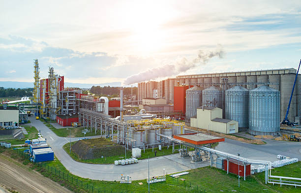 Sunset over biofuel factory stock photo