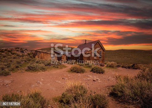 Sunset over Bodie ghost town in California. Bodie is a historic state park from a gold rush era  in the Bodie Hills east of the Sierra Nevada.