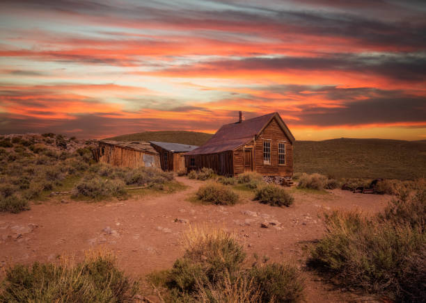 sunset over bodie ghost town in california - western town stock photos and pictures