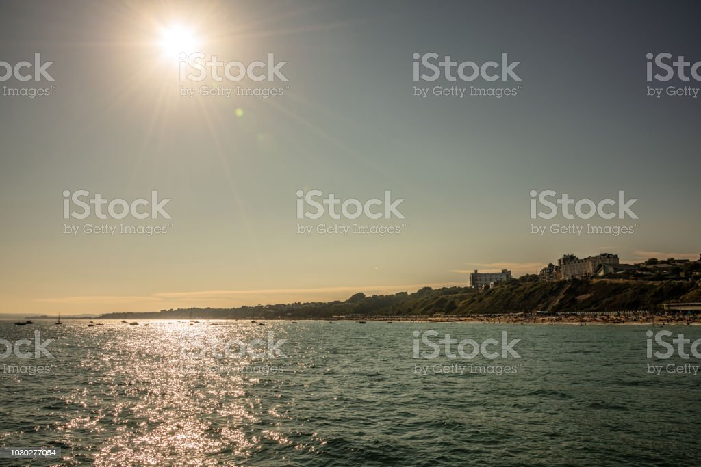 Sunset over Bournemouth beach and West Cliff stock photo