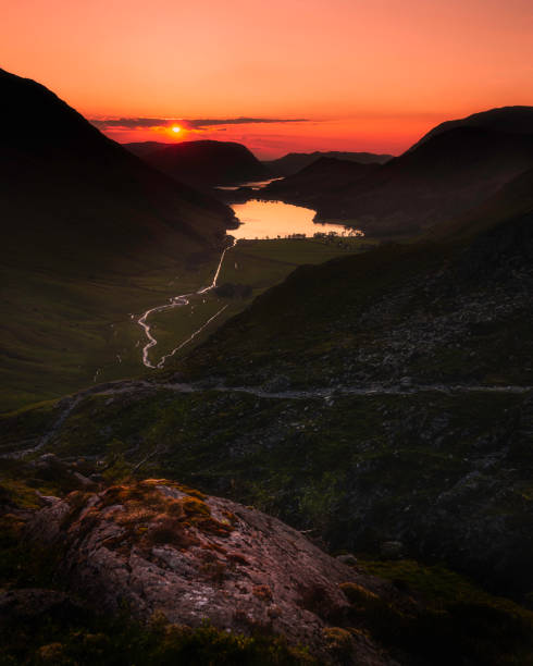 Sunset over Buttermere lake in Lake District, Cumbria, UK. stock photo
