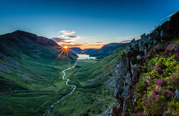 Sunset over Buttermere Sunset over Buttermere, The Lake District, Cumbria, England cumbria stock pictures, royalty-free photos & images