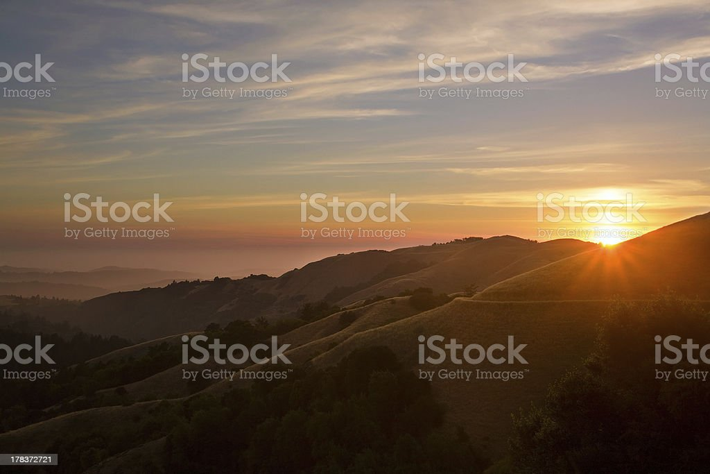 Sunset over California Mountains and Pacific Ocean stock photo