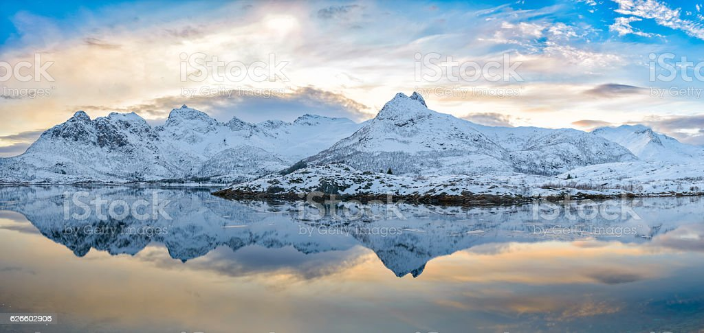 Sunset over calm husvågen winter lake in the Lofoten Norway stock photo
