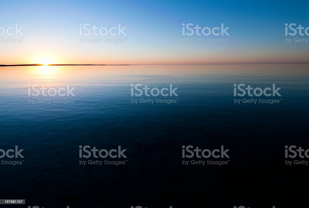 Sunset Over Calm Water stock photo