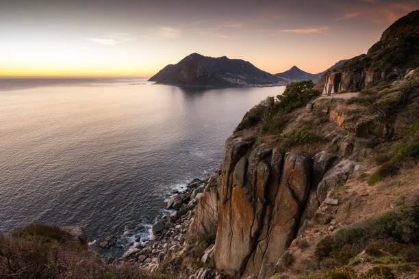 sunset over chapman's peak drive near cape town, south africa - cape peninsula stock pictures, royalty-free photos & images