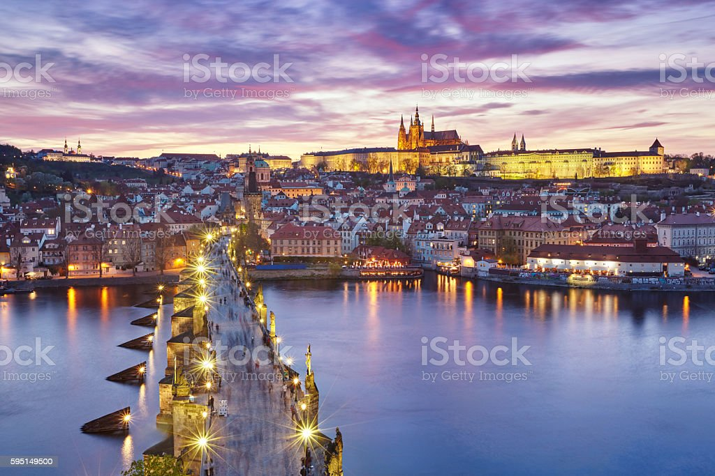 sunset over Charles Bridge and Prague Castle stock photo