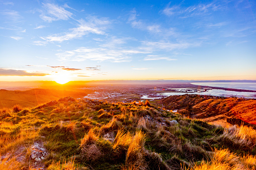 An autumn sunset over the largest city in New Zealand's South Island. Photographed from Mt. Pleasant in the Port Hills.