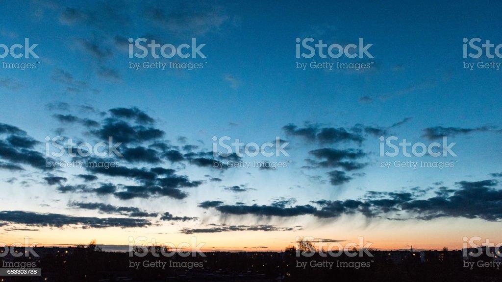sunset over city ロイヤリティフリーストックフォト