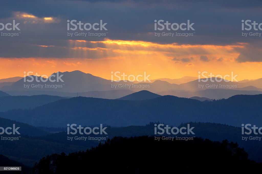 Sunset over color mountain silhouette. stock photo