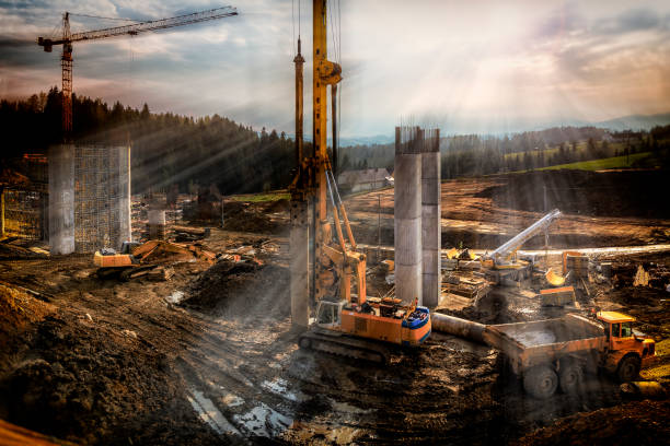 sunset over construction of the viaduct on the new s7 highway, poland - pillar drill stock photos and pictures