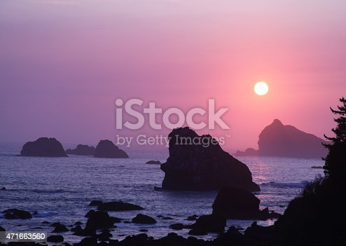 Crescent City, California is a small town near the Oregon border with fantastic views of the Pacific Ocean and lots of public beaches.  This location in Del Norte County is near large areas of old growth redwood forests. Sea stacks create a wonderful sunset view of the ocean.