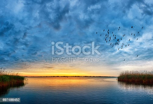 horizontal shot of nature background, sunset view over Danube river.