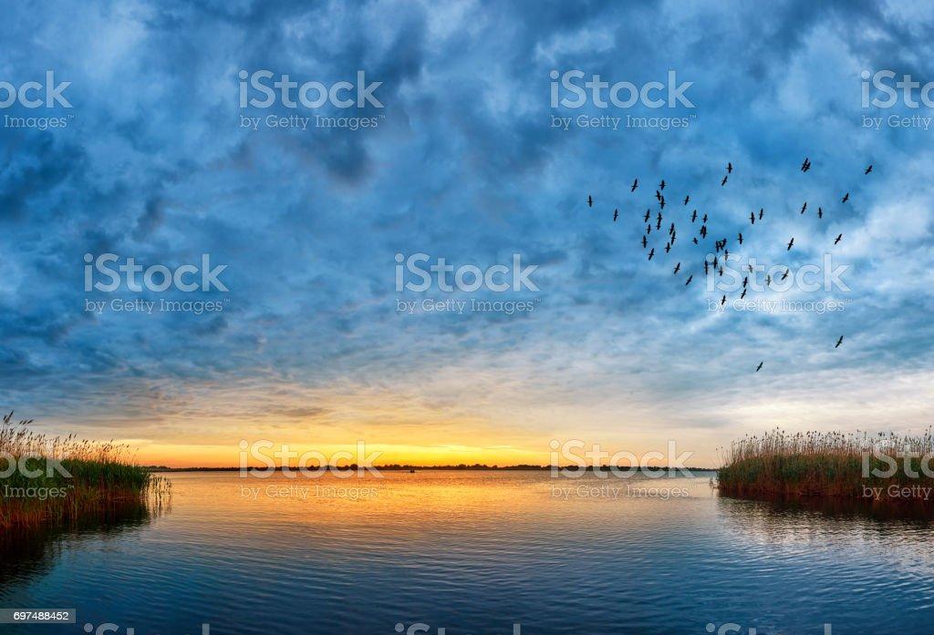 sunset over Danube river stock photo
