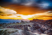 The sun setting at Zabriskie Point, which appears as though on a different planet, in Death Valley National Park.