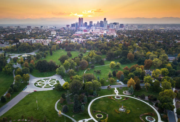 sunset over denver cityscape, aerial view from the park - public park stock photos and pictures