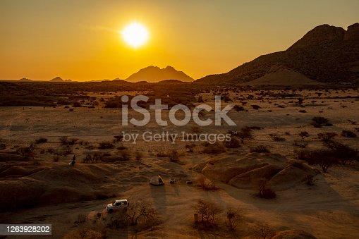Sunny sunset over barren prairie