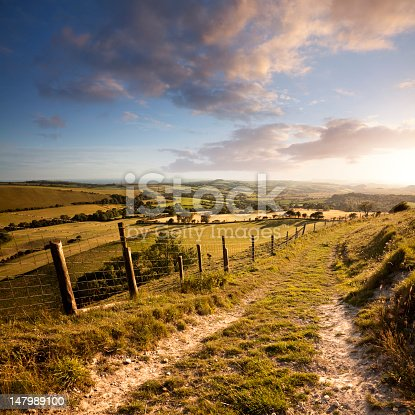 istock Sunset over English countryside with footpath in Dorset 147989100