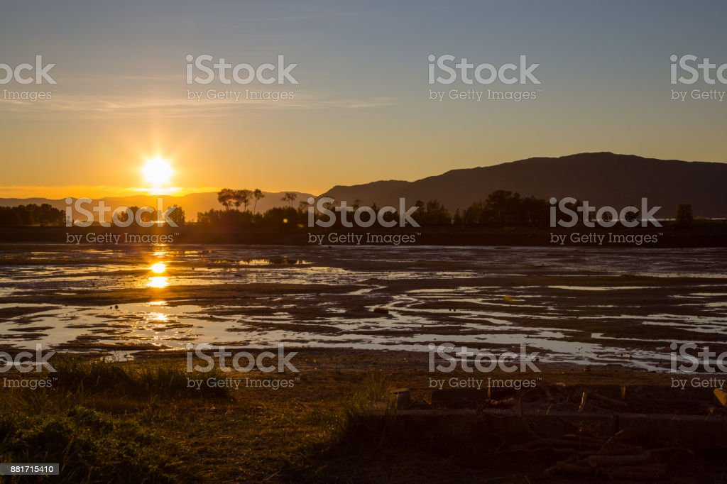 Sonnenuntergang über Ebbe – Foto