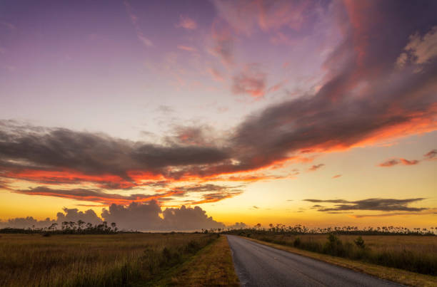 Sunset over Florida's Everglades National Park along the roadway stock photo