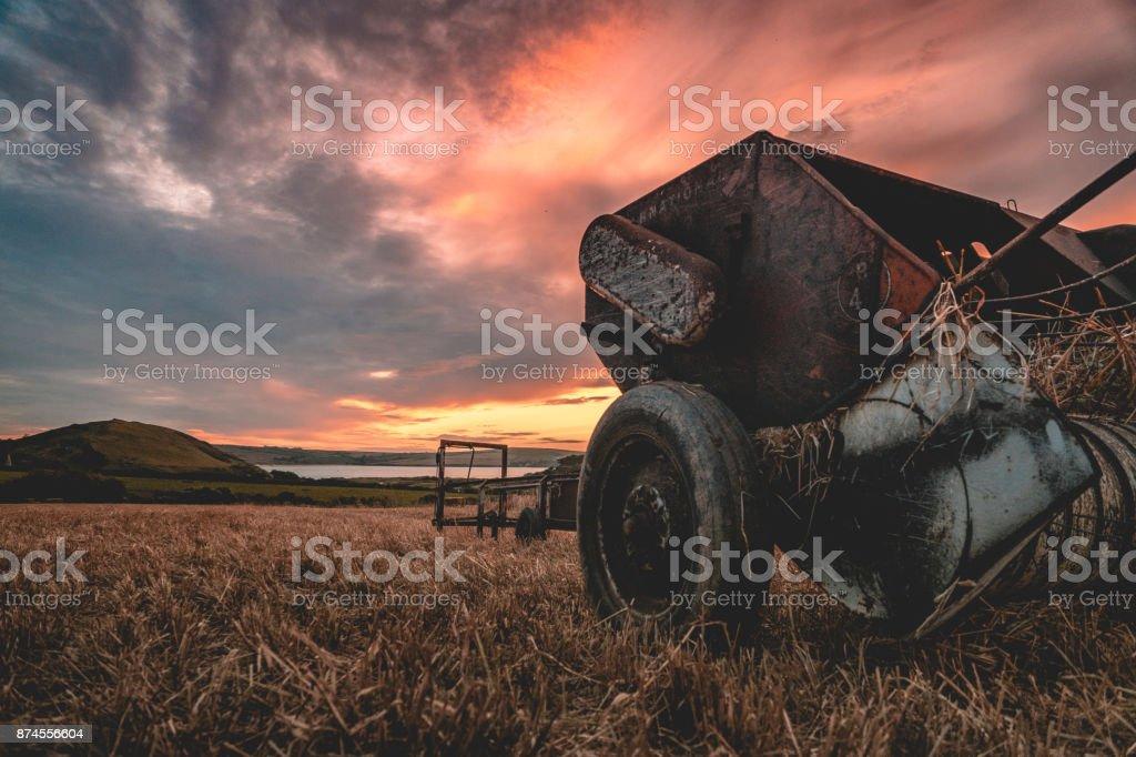 Sunset over fresh harvested fields stock photo