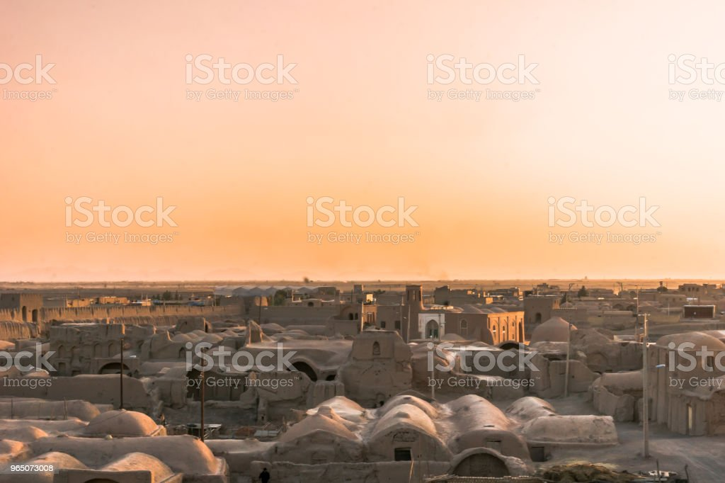 Sunset over ghost town of Ghoortan citadell by Varzaneh in Iran royalty-free stock photo