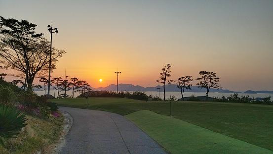 Sunset over seaside golf course, in Yeosu, Korea