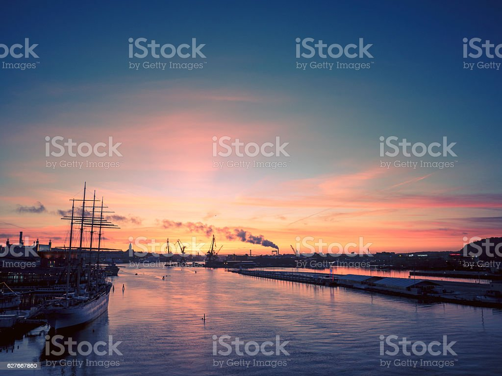 Sunset over Gothenburg harbor in Sweden stock photo