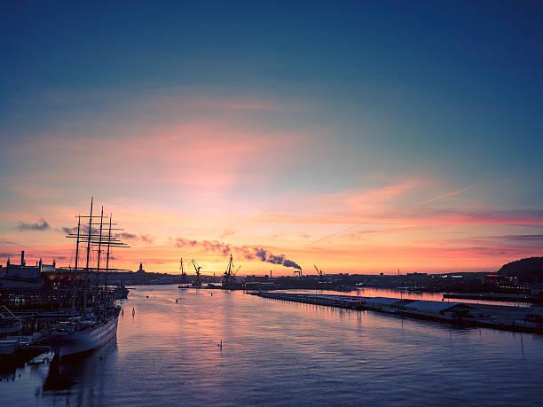 Sunset over Gothenburg harbor in Sweden stock photo