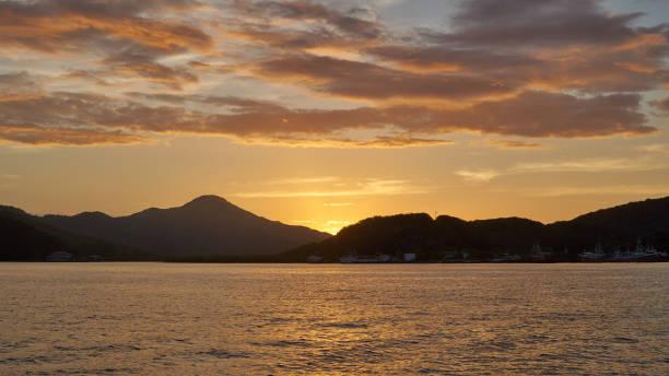 Sunset over Guanaja island stock photo