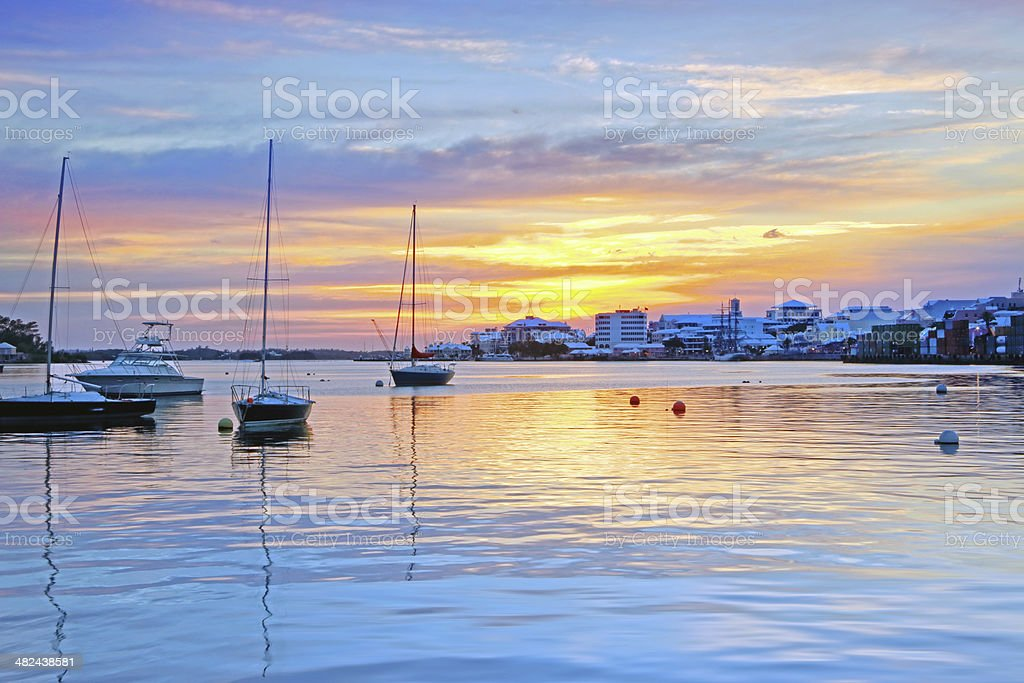 A sunset over Hamilton harbor with moored vessels. stock photo