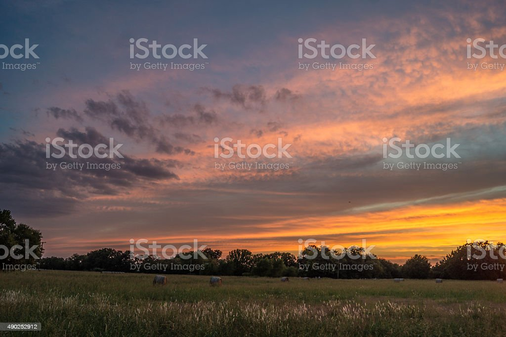 Sunset over hay bales and field in Sunnyvale, Texas stock photo