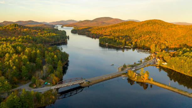Sunset over Highway 30 Crossing Long Lake at Adirondacks Park Upstate NY stock photo