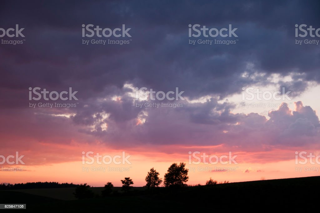 Sunset over hill stock photo
